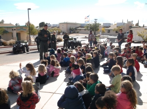 Border Patrol 2013 Kids Listening with Flag