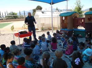 Pre-School Director Brad Dale leads an outdoor seminar in Earth-friendly lifestyles