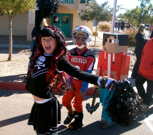 Middle schoolers get into the Halloween spirit of the parade with football and Roblox themes.