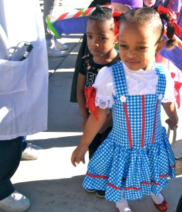 Preschoolers participate in the Halloween parade in costumes. A young