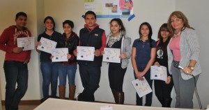 Recipients pose with Principal Munguia with their certificates.
