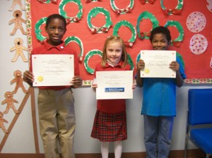 Overall spelling bee winners display their award certificates.