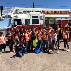 5th graders pose with fire truck at Douglas Fire Department