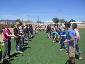Students team up to compete in the water balloon toss
