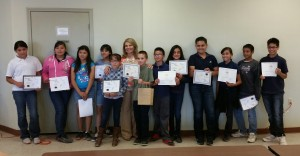 Students proudly display their achievement awards following the ceremony