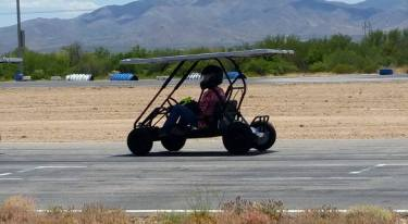 Team Member, Sara S., races around the track in one of the CAS team's go karts