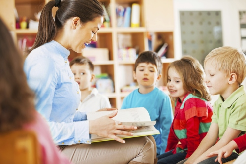 kindergarten-teacher-reading-to-children-1