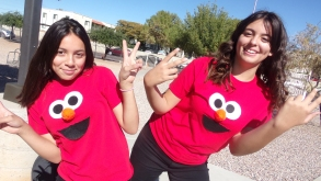 Female middle school students wearing matching Elmo shirts