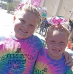 Two young girl students wearing matching tie dye shirts