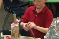 Second grade student building rocket ship out of paper towel rolls in STEAM Up program